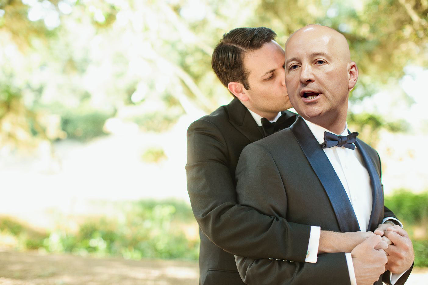 Pete Ricketts and boyfriend Steve Kandor pose embracing each other.