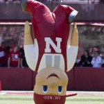 Nebraska mascot Lil' Red bounces on his head prior to the annual Red-White spring college football game, in Lincoln, Neb., Saturday, April 17, 2010. The Red team beat the White team 21-16.(AP Photo/Nati Harnik) ORG XMIT: NENH101