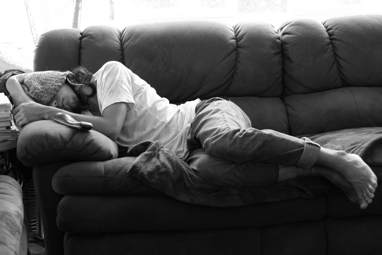Man asleep on his parent's couch