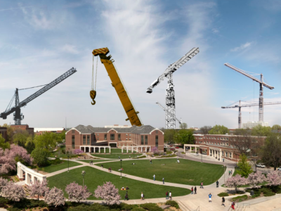 North-facing photo from the Nebraska Union showing multiple cranes scattered across campus.